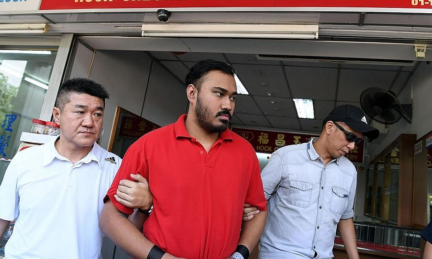 M. Jegatheesh was brought back to Hock Cheong Jade and Jewellery shop by the police on Aug 21 last year. He was jailed for three years and three months and sentenced to six strokes of the cane yesterday for his role in the robbery on Aug 14 last year