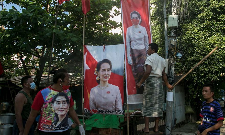 Supporters of the National League for Democracy with banners of Myanmar State Counsellor Aung San Suu Kyi on Tuesday.