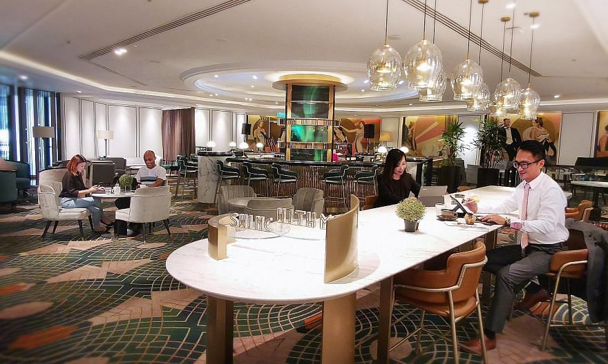 Orchard Hotel Singapore has retrofitted the sleek space in its Bar Intermezzo for co-working, adding black power plugs under marble coffee tables and bar counters.