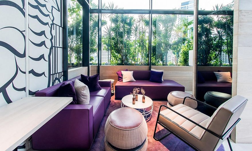 A meeting room, individual tables and sofa seats (above) are all part of a small co-working space called the Komyuniti Studio, tucked in a corner of Yotel Singapore's in-house restaurant-cum-bar. Co-working packages at Komyuniti Studio come with meal