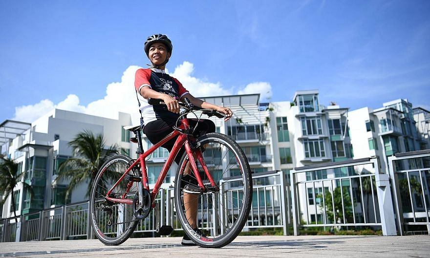 Ms Jannah Pascua, who has completed seven marathons, logged 121km in this year's virtual OCBC Cycle event to help raise $30,000 for non-governmental organisation Aidha.