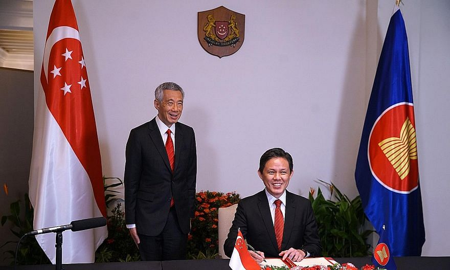Prime Minister Lee Hsien Loong witnessing the signing of the Regional Comprehensive Economic Partnership (RCEP) agreement by Trade and Industry Minister Chan Chun Sing yesterday. The trade pact was signed virtually by all 10 Asean members and key par