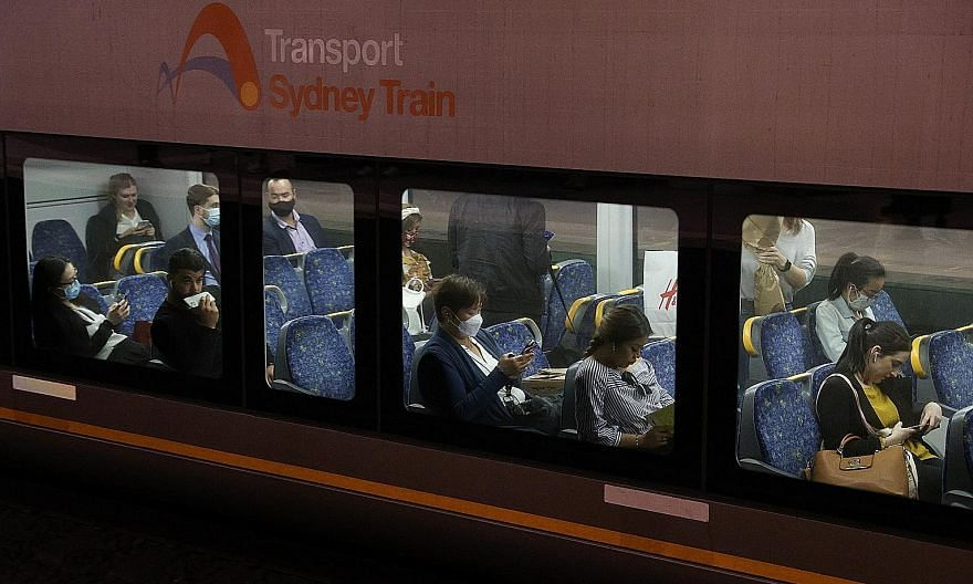 Commuters on a train in Sydney, Australia, last week. Almost 70 per cent of Australia's population of 25.6 million residents live in the eight capital cities. More than 40 per cent live in Sydney and Melbourne.