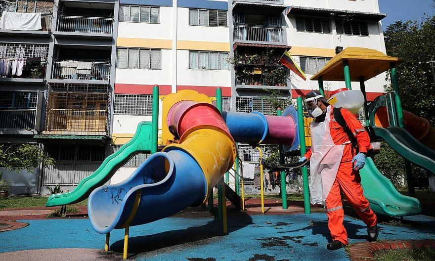A worker disinfecting a playground in Kuala Lumpur. Under the more relaxed CMCO, which covers nine of Malaysia's 13 states and all three federal territories - Kuala Lumpur, Putrajaya and Labuan - the public can still travel to work and shop but canno