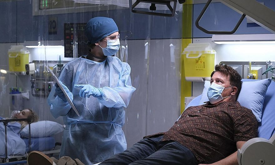 Dr Shaun Murphy, played by Freddie Highmore (left), treats a patient during the early days of the Covid-19 pandemic in the drama The Good Doctor.