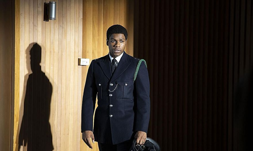 In the film Red, White And Blue, John Boyega (left) plays Leroy Logan, a forensics scientist who becomes a police officer after Logan's father is assaulted by two white officers acting on racist impulses. The film, which is based on a true story, is