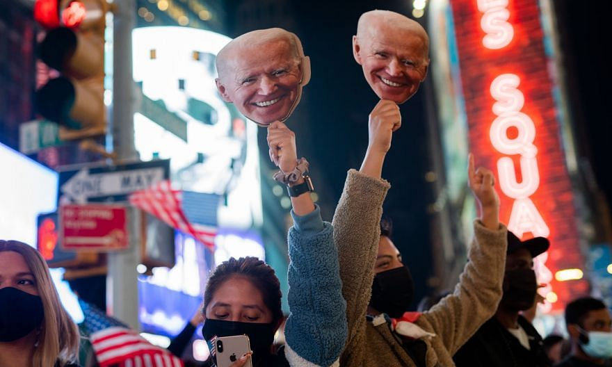 "United States President-elect Joe Biden's supporters celebrating his election win in New York on Nov 7. Singapore's Prime Minister Lee Hsien Loong said he hopes that the Biden administration will take ""a more coherent, systematic approach"" in the US'"