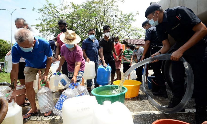 Residents of Puchong Jaya, Selangor, collecting water last month. In at least eight incidents this year, pollutants were dumped into rivers, leading to unscheduled water cuts in Selangor and Kuala Lumpur.