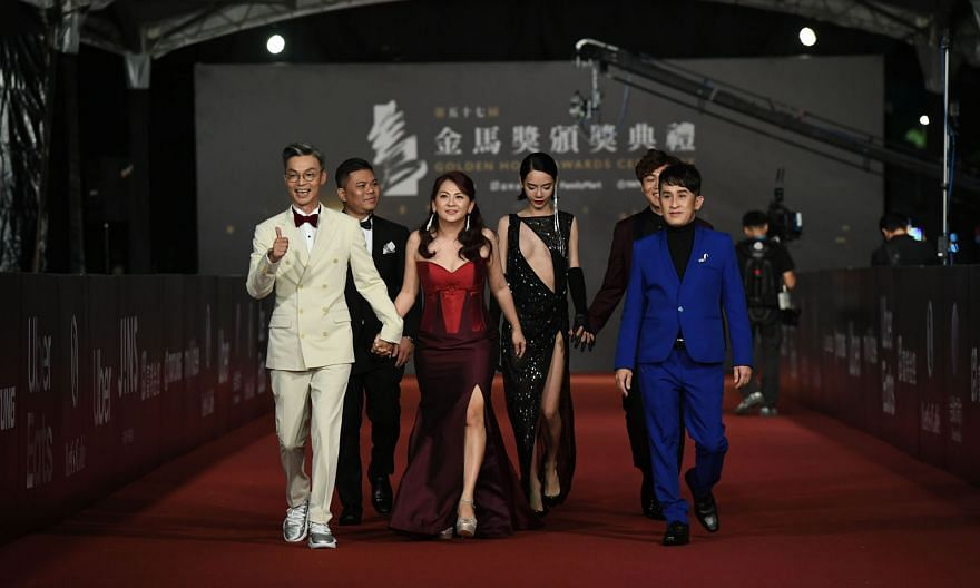 Director Chen Yu-hsun (second from left) and his team at the awards ceremony yesterday, after winning the Best Narrative Feature award for My Missing Valentine. On the red carpet at the Golden Horse Awards in Taipei yesterday were (first row, from le