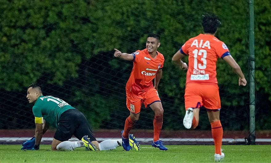 Albirex forward Fairoz Hasan celebrating his goal that put the side 2-1 up against the Lion City Sailors in their SPL match at Bishan Stadium yesterday.