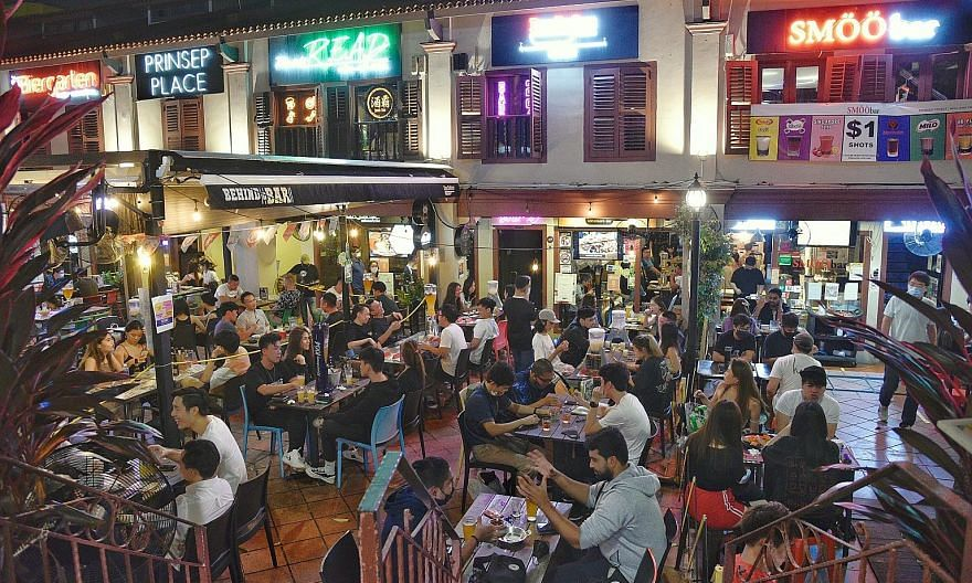 People dining at Prinsep Place last Friday night while practising safe distancing measures. Since Nov 1, there have been fewer locally transmitted cases, with two from the community and five from the dorms on Nov 3, 4, 5 and 10. Most cases have been