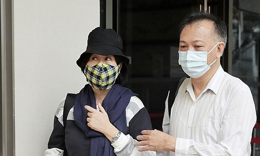 Madam Chan Hui Peng, seen here with her husband Sim Kuang Jui, says the 2015 accident caused her to suffer from PTSD and schizophrenia. ST PHOTO: GAVIN FOO