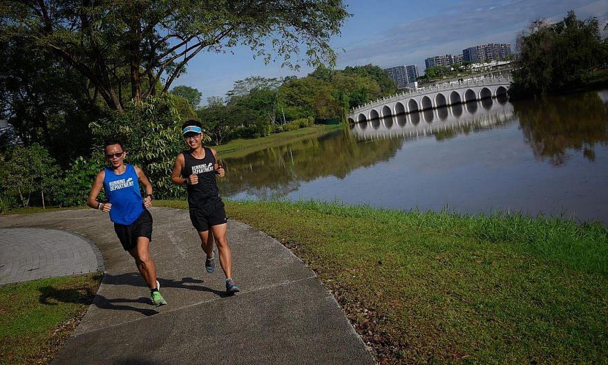 The White Rainbow Bridge at Jurong Lake (background) is among the scenic spots in a Culture Shapers route by the Ironman Group and Singapore Tourism Board, as part of the Standard Chartered Singapore Marathon.