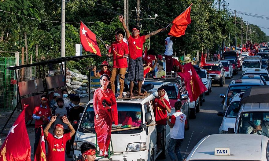 Supporters of the National League for Democracy party celebrating with a cut-out figure of Myanmar state counsellor Aung San Suu Kyi in Yangon on Nov 10. The party secured a landslide victory despite the government's weak performance on its key pledg