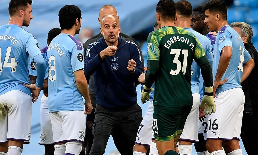 Manchester City manager Pep Guardiola speaking to his players during their English Premier League win over Liverpool at the Etihad Stadium in July. The Spaniard admits that he needs a new game plan to get his side scoring again. PHOTO: AGENCE FRANCE-