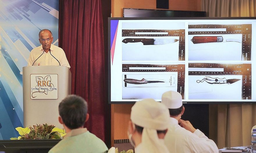 Home Affairs and Law Minister K. Shanmugam speaking during the Religious Rehabilitation Group's seminar at Khadijah Mosque yesterday. He said regional terrorists are adapting and diversifying the way they carry out attacks - for instance, by favourin