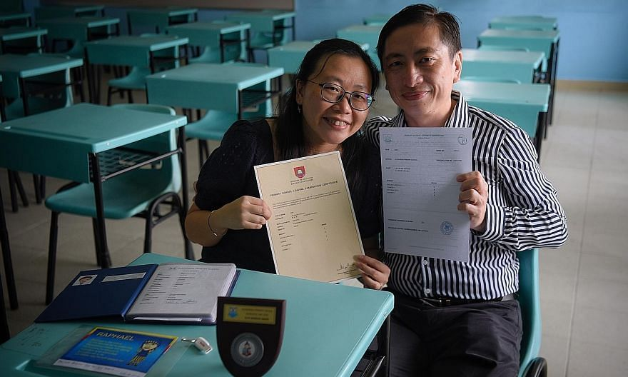 Mr William Lee and Mrs Winnie Lee with the PSLE result slip and certificate of their son Raphael (below) at Alexandra Primary School yesterday. The 12-year-old died on Nov 13.