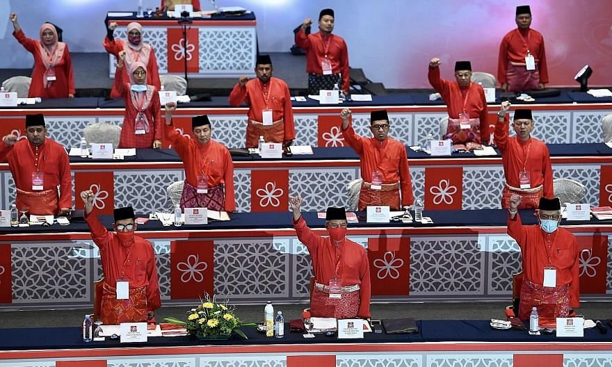 Parti Pribumi Bersatu Malaysia president Tan Sri Muhyiddin Yassin (front row, centre) at the party's annual general assembly yesterday. His Perikatan Nasional government's budget got past the second reading last week. PHOTO: BERNAMA