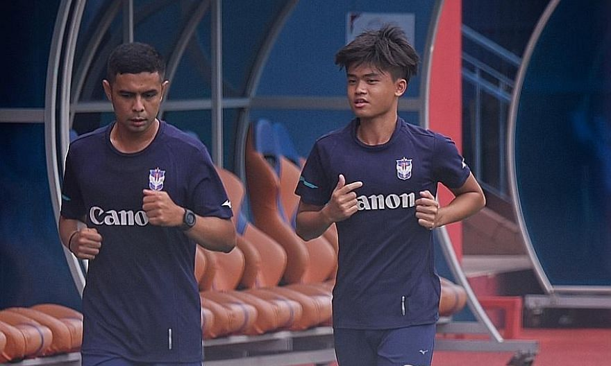 Albirex Niigata's veteran Fairoz Hasan and teenager Ong Yu En training at Jurong East Stadium on Friday. Albirex are chasing their fourth SPL title, while closest rivals Tampines are aiming for their sixth.