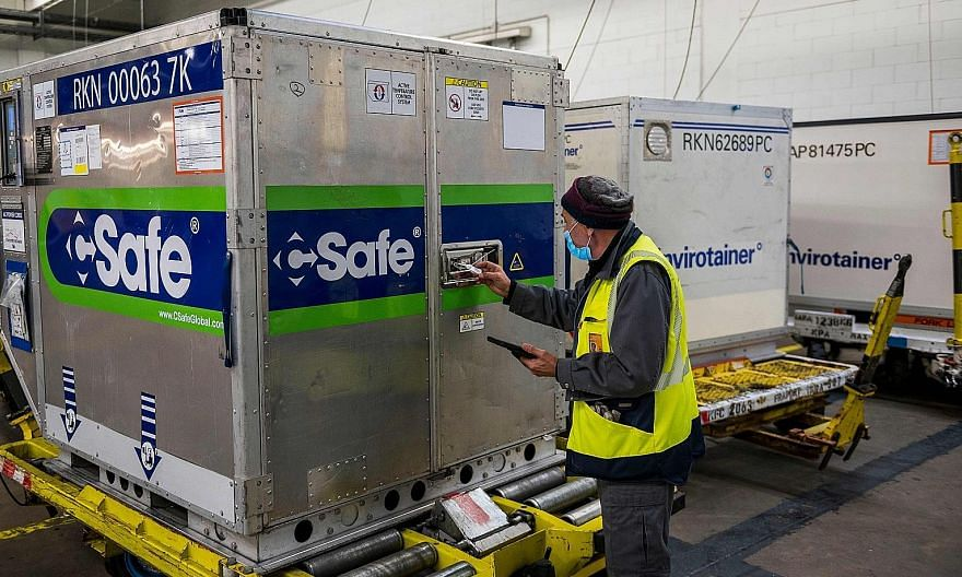 A worker checking a temperature-controlled container at Lufthansa Cargo's pharmaceutical hub in Frankfurt Airport last week.