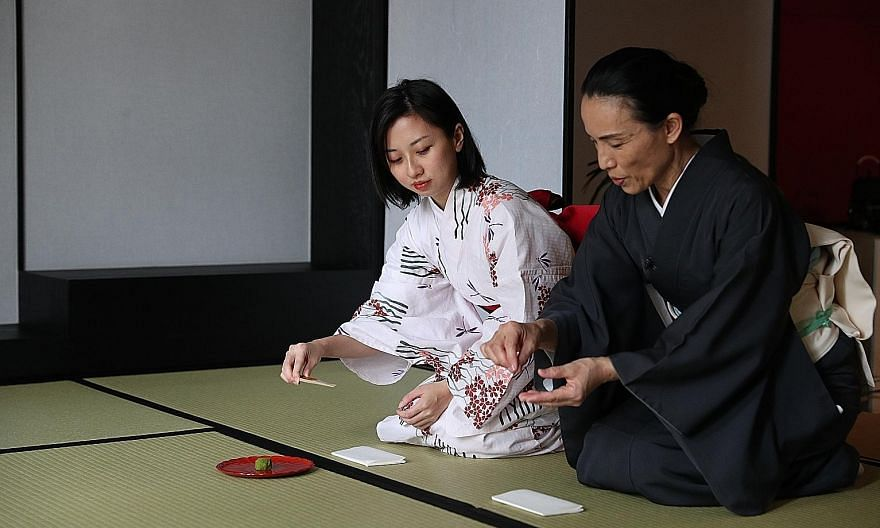 The writer (far left) learns proper Japanese tea ceremony etiquette from Ms Yasuko Norris (left), a tea ceremony teacher and kimono dresser. (Clockwise from above) Keyaki at Pan Pacific Singapore is situated within a quaint Japanese garden; a katsu d