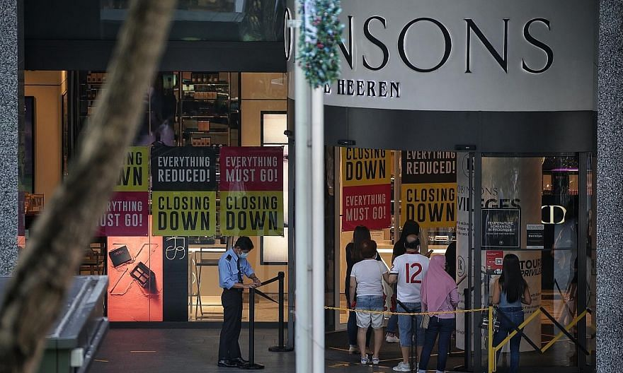 Shoppers queueing to enter Robinsons at The Heeren. The department store is closing down its last two stores here and owes at least $31.7 million to more than 440 creditors. ST PHOTO: KEVIN LIM