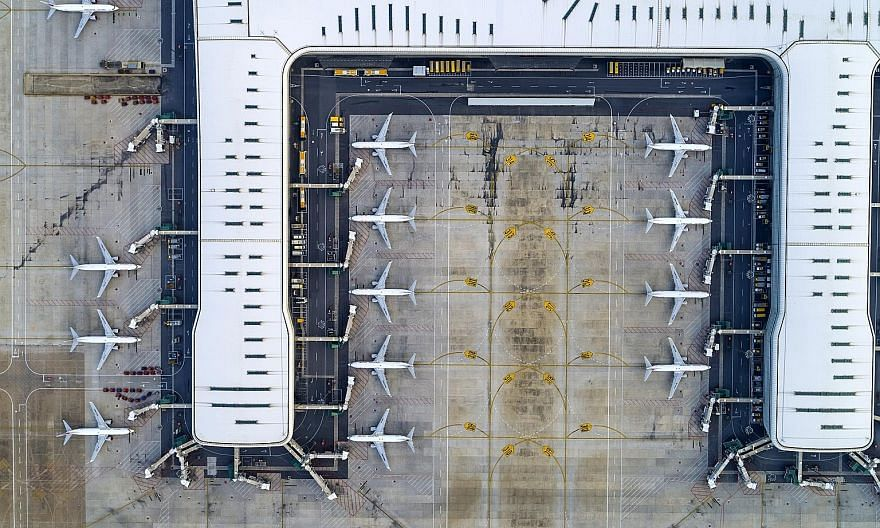 Passenger planes at the Wuhan Tianhe International Airport in Wuhan, Hubei province, China, on Jan 29. Thousands of pilots have been laid off or furloughed, and those still in work are flying a lot less because airlines have grounded planes and scale