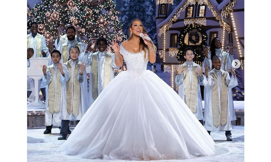 The pop diva (left) performs with guest stars Ariana Grande and Jennifer Hudson in Mariah Carey's Magical Christmas Special.
