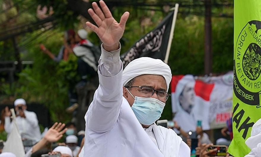 Cleric Rizieq Shihab waving to supporters on Nov 10 after his return to Indonesia. He has cancelled plans for future gatherings. PHOTO: AGENCE FRANCE-PRESSE