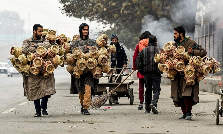 Vendors carrying kangri (earthen pots covered with wicker) in Srinagar last month. The writer dreams of India as a model of religious diversity and harmony, with a vibrant democracy and strong adherence to the rule of law, a country with admirable so