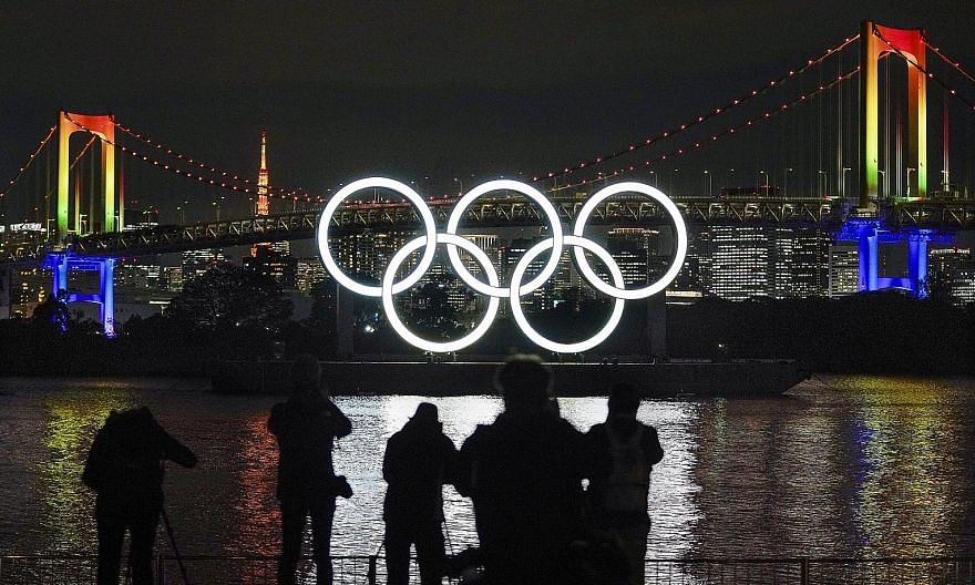 The Olympic rings have been reinstalled at their original location at the Odaiba Marine Park in Tokyo, with the rearranged Summer Games scheduled to go ahead next July.