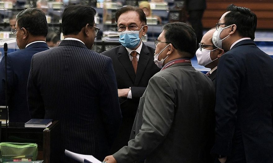 Opposition leader Anwar Ibrahim with other MPs during a split vote for the committee-level Supply Bill in Malaysia's Parliament yesterday. The Perikatan Nasional government has been able to secure approval for every individual ministry's allocation s