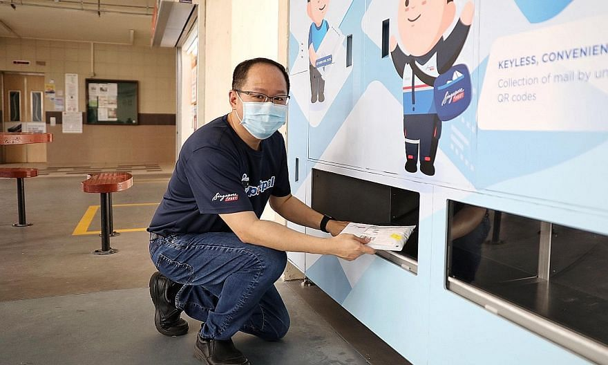 Mr Edmund Tan, vice-president of SingPost's innovation team, demonstrating how to use the PostPal smart letterbox system at its unveiling at Block 202 Clementi Avenue 6 yesterday. Instead of having to sort and slot mail into individual letterboxes, p