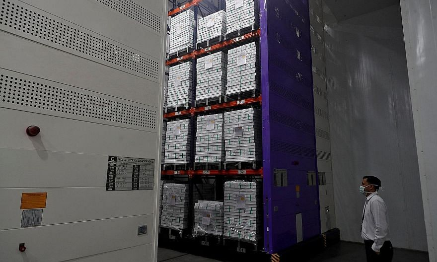 Boxes with vials of AstraZeneca's Covid-19 vaccine inside a cold room at the Serum Institute of India, in Pune, on Monday. India, the world's second-most populous country with a population of 1.35 billion, is also the second-most affected by Covid-19