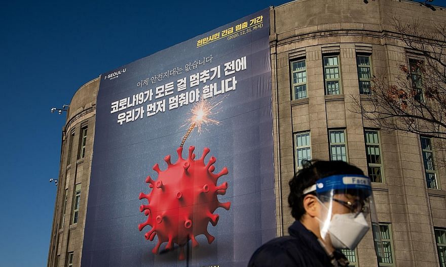 A Covid-19 banner outside the Seoul Metropolitan Library. The South Korean capital is facing a desperately dangerous crisis, says its acting mayor Seo Jeong-hyup. PHOTO: BLOOMBERG