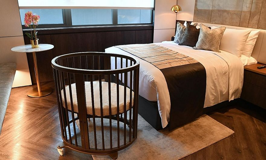 Kai Suites' rooms (above) are fitted out with queen-and king-size beds as fathers are encouraged to stay over while bassinets are provided for the babies. Confinement meals (left) are planned in consultation with nutritionists and TCM practitioners.