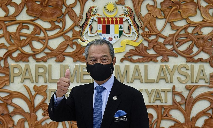 """Former Malaysian premier Mahathir Mohamad (right) resigned in February amid cracks in the Pakatan Harapan coalition. It is unclear when the phrase """"backdoor government"""" was first used, but one PH leader used it as early as Feb 23 when leaders of seve"""