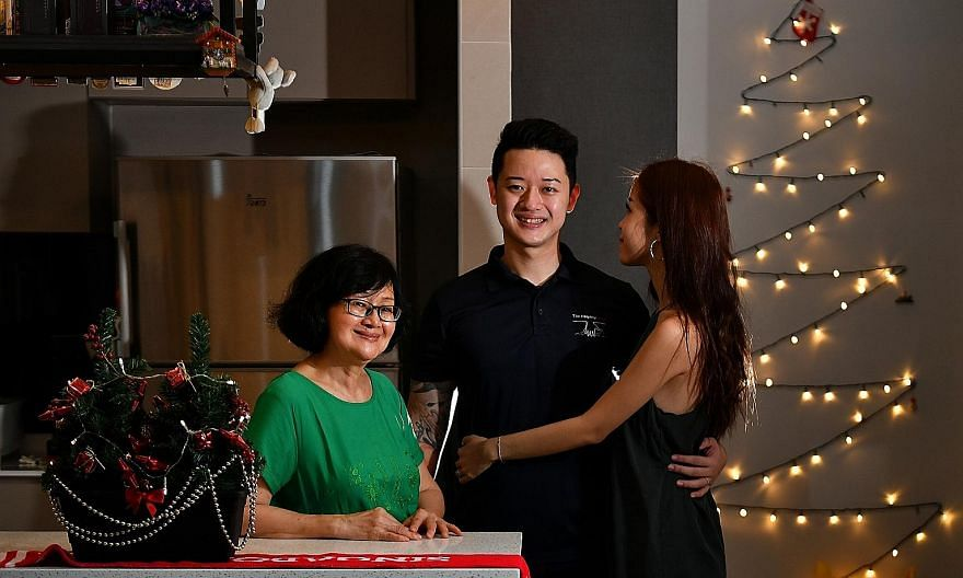 Former drug addict Leau Ian Tong, 32, with his mother, Madam Loo, 66, and girlfriend, at his sister's home on Christmas Eve. ST PHOTO: LIM YAOHUI