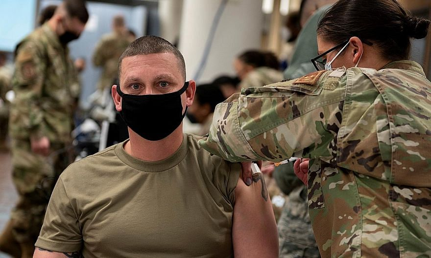 A US Air Force soldier getting a coronavirus vaccine at Osan Air Base in Pyeongtaek, South Korea, yesterday. The majority of South Koreans will get their shots only in February or March when the country's first purchased vaccines - from British-Swedi
