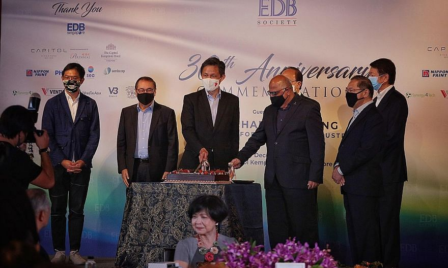 At the Economic Development Board Society's 30th anniversary event at the Capitol Kempinski Hotel yesterday were (from left) EDB managing director Chng Kai Fong, DBS Group Holdings chairman Peter Seah, Trade and Industry Minister Chan Chun Sing, EDB