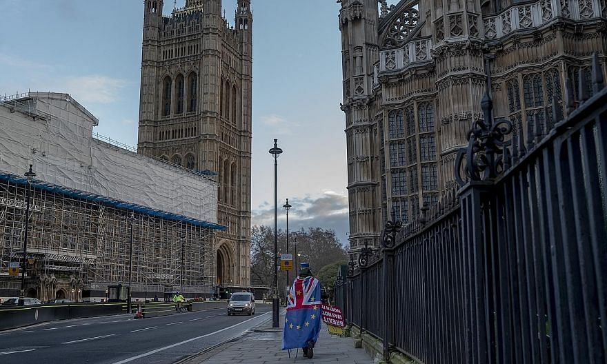 A lone European Union supporter outside the British Parliament in London on Wednesday. Brexit, in essence, takes place at the stroke of midnight in Brussels, or 11pm London time (7am today Singapore time). PHOTO: NYTIMES