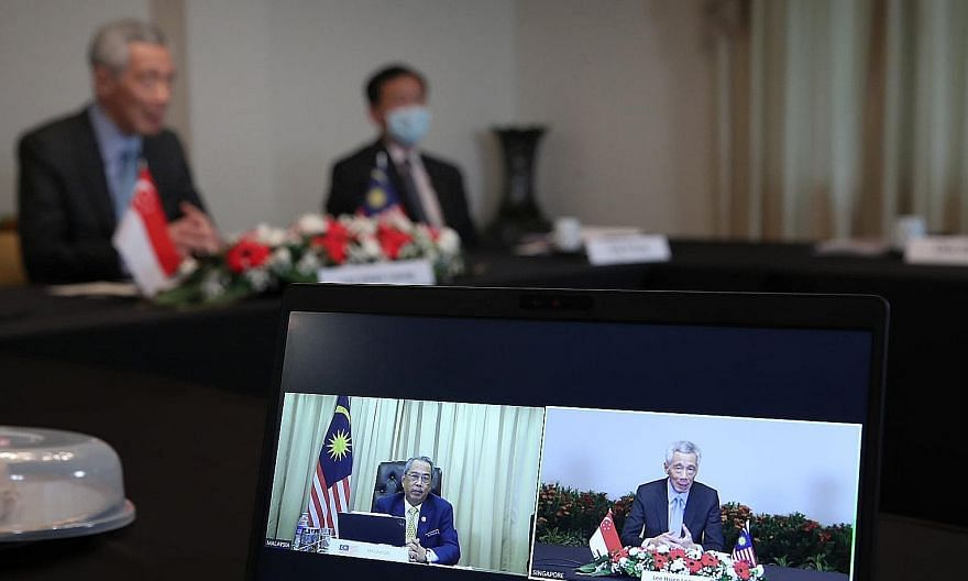 Prime Minister Lee Hsien Loong and Malaysian PM Muhyiddin Yassin discussing the high-speed rail link via videoconference on Dec 2. The aborted project is unlikely to alter the tenor of bilateral relations between Singapore and Malaysia, says one expe