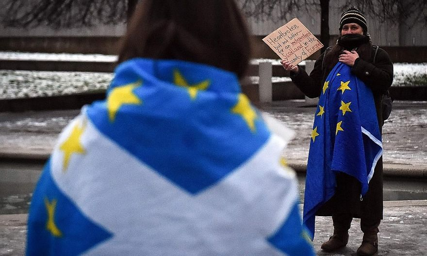 Pro-Scottish independence activists with European Union flags during a protest in Edinburgh last Thursday against Britain's exit from the bloc. A recent poll shows a record 58 per cent of Scots now back leaving the United Kingdom. PHOTO: AGENCE FRANC