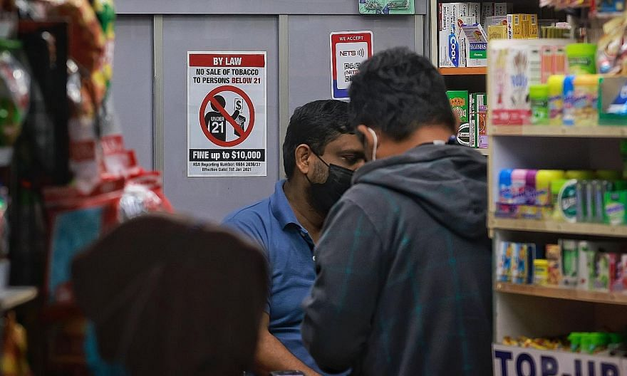 A sign in a convenience store at Bedok Interchange Food Centre showing the updated minimum age of 21 for people buying tobacco products. Other measures in the Government's anti-smoking arsenal include public education, taxation, cessation programmes