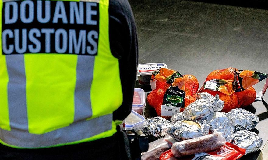 This photo taken last Wednesday shows goods laid out while a Dutch customs officer checked vehicles getting off the ferry from the United Kingdom in Hoek van Holland, as new import and export rules apply following the Brexit deal.