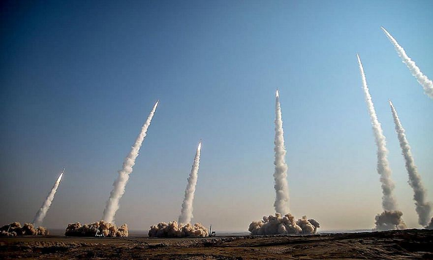 Missiles being launched during the drill by Iran's Revolutionary Guards. The military exercise was Iran's third in less than two weeks, and comes amid rising tensions with the US.