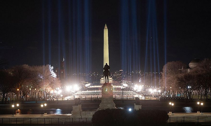 The Washington Monument framed by spotlights on the National Mall on Saturday as preparations were under way ahead of President-elect Joe Biden's inauguration ceremony this Wednesday in Washington. Thousands of National Guard troops have been deploye