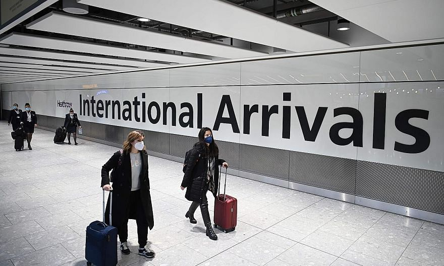 Passengers at the arrivals hall of London's Heathrow Airport last Friday. While many in the travel industry predict a robust recovery in leisure travel once borders can properly reopen, business travel faces a severe crisis. PHOTO: AGENCE FRANCE-PRES