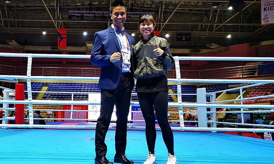 Kickboxing Federation of Singapore vice-president Joel Lye and general secretary Valencia Yip at the 2019 SEA Games in the Philippines. Both officials have been handed three-year bans by the Asian Kickboxing Confederation.