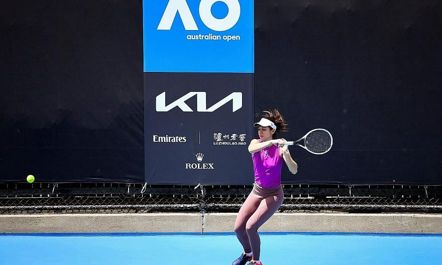 Romania's Ioana Raluca Olaru training ahead of the Australian Open yesterday. While she is able to practise on the court, 72 players are confined to their hotel rooms, where some have resorted to hitting balls against the wall.